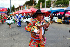 Ch'uta playing a charango during parades for the Entierro del Pepino, La Paz, Bolivia