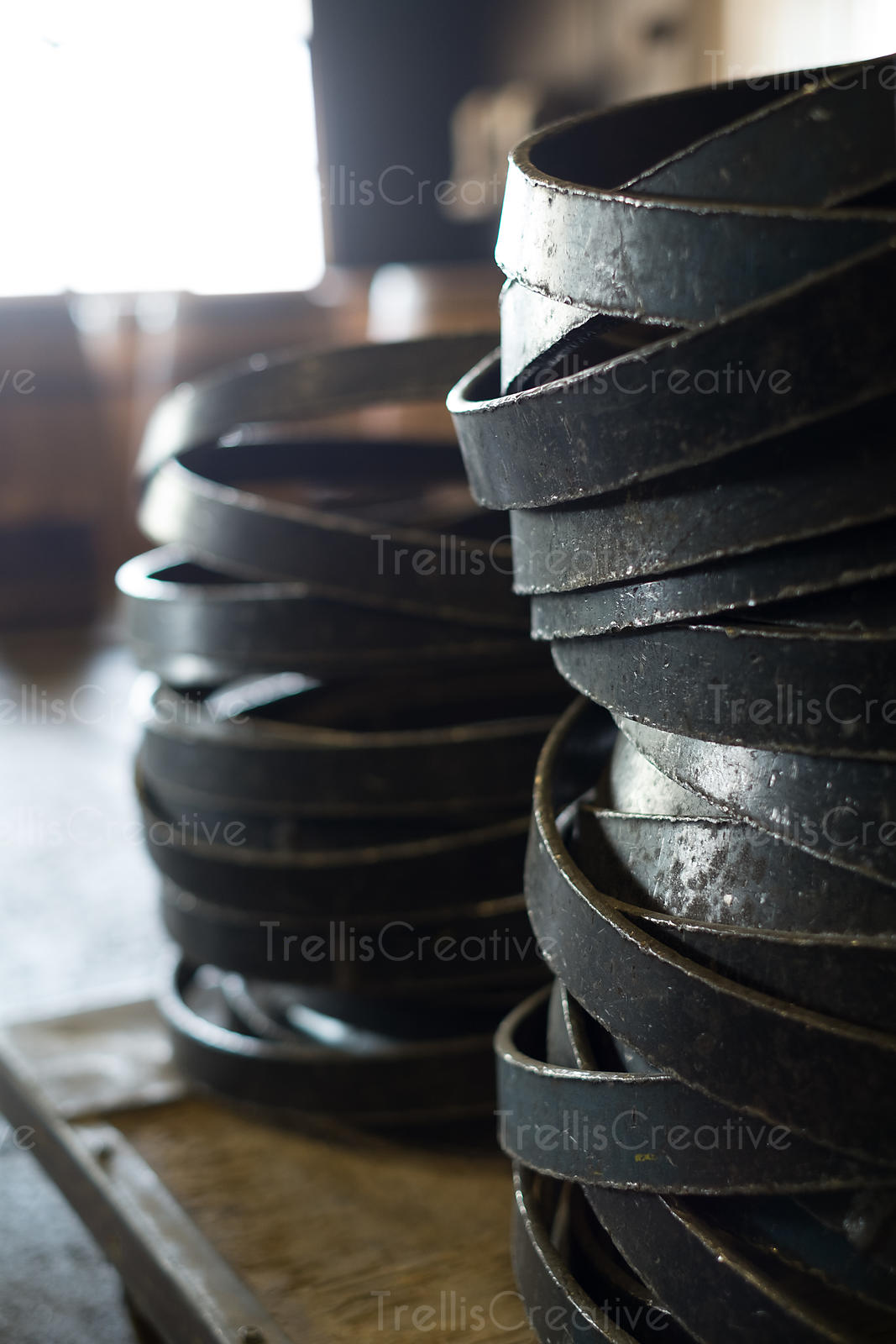 Stacks of iron barrel rings on a table.