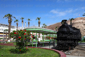 Old steam train in Plaza del Tren, El Morro headland in background, Arica, Region XV, Chile