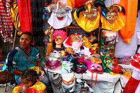 Pepino and other carnival masks for sale outside a costume hire / rental shop, La Paz, Bolivia