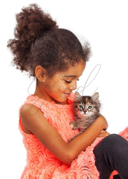 Cute Girl With Kitten Looking at Camera