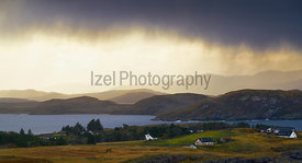 Heavy rain clouds over coastal crofts at Mellon Charle,  Loch Ewe, Scottish Highlands, Scotland, UK.