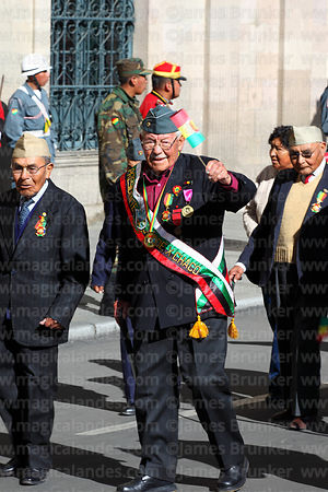Chaco War veterans pass the presidential palace during civic parades for Independence Day, La Paz, Bolivia