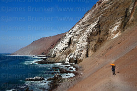 Tourist walking on the Cuevas de Anzota trail near Arica, Region XV, Chile
