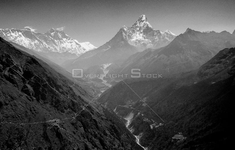 NEPAL Mount Ama Dablam -- 16 Apr 2005 -- Aerial view of Mount Ama Dablam (right, 6,856m), Mount Lhotse (left, 8,414) and on the far left peeping over the Lhotse ridge is Mount Everest itself.
