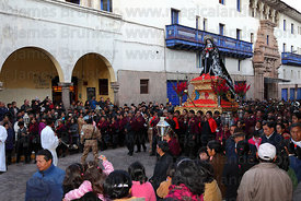 Crowds with figure of Virgen Dolorosa during Good Friday procession , Cusco , Peru