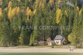A small church Cappella Lago di Braies, Lago a beautiful Alpine lake in wonderful autumn colour.  The Braies lake is in Dolomites, South Tyrol, Italy.