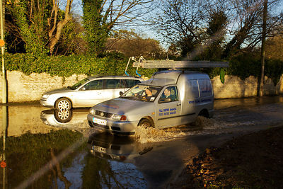 Van Driving through flooded street in Kidlington Oxfordshire