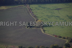 Farming Landscape aerial photograph showing fields lying fallow and ploughed fields divided by trees and hedgerows