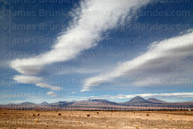 View across desert near San Pedro de Atacama to Licancabur (R) and Juriques (far R) volcanos, Region II, Chile
