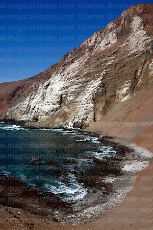 Rocky coastline on Cuevas de Anzota trail near Arica, Region XV, Chile
