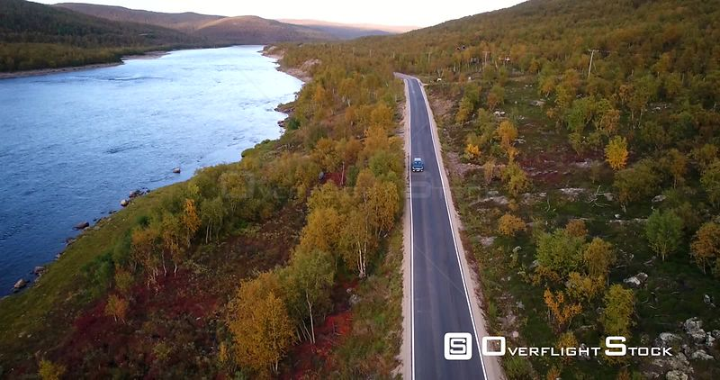 Autumn Color Road, Aerial View of a Car Driving on Road 970 the Tenontie, Near Tenojoki River, at the Border of Norway and Utsjoki, on a Sunny Evening Dawn, in Lapland, Finland