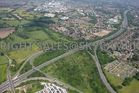 High level view across the M56 motorway Junction 5 and Airport Spur towards Farmland Roaring Gate Lane and Thorley Lane to the west of Manchester Airport