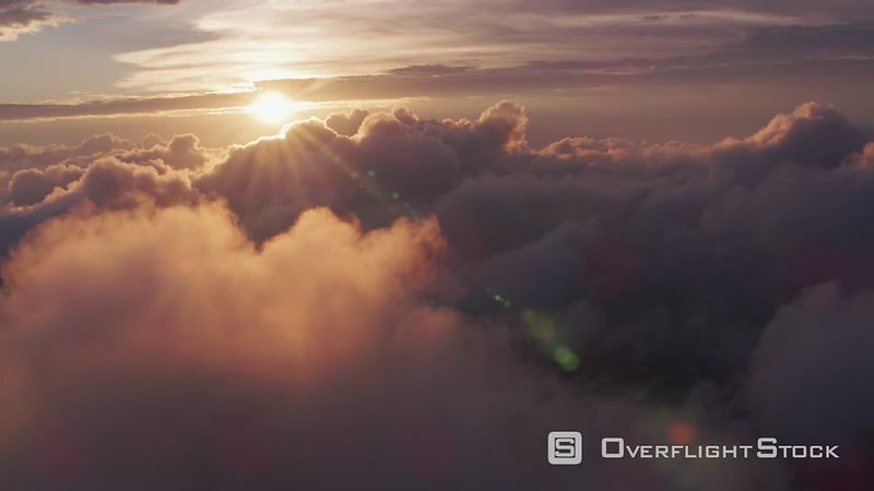 New York City Aerial view of sunrise over clouds with New York City below.  Shot with Cineflex and RED EpicW Helium.