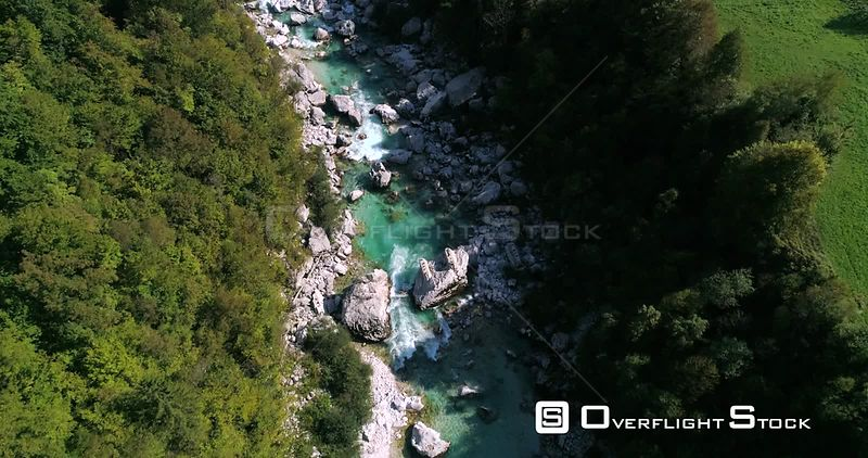 Alpine rapids, C4K aerial drone view, low over turquoise soca river, in the alp nature, near Trigolov national park, on a sunny summer day, in the Julian alps, Slovenia