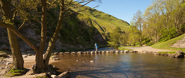 American man on stepping stones Dovedale