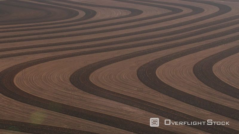 Aerial view of plowed patterns in field