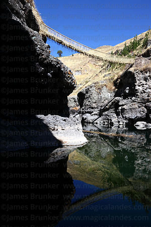 Newly rebuilt Inca rope suspension bridge across the Apurimac River at Q'eswachaka, Canas province, Peru