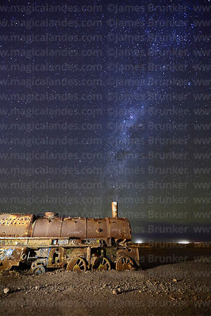 Milky Way above old steam train in train cemetery, Uyuni, Bolivia