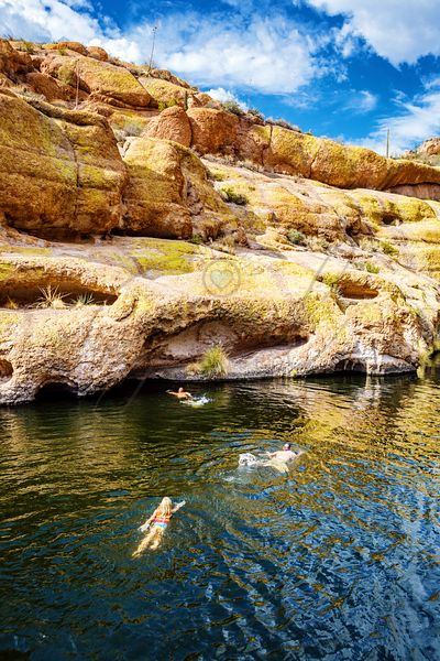 People Swimming in Arizona Lake Towards Canyon Walls
