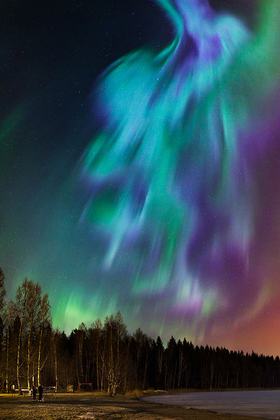 Bystanders watching the movement of northern lights above Southern Finland on March 18 2015.