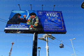Billboard with Bolivian presidetn Evo Morales next to newly opened Blue Line cable cars, Rio Seco, El Alto, Bolivia