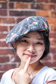 Portrait of smiling chinese girl wearing hat, Shanghai, China