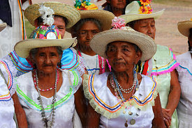 Abadesas waiting outside church for main procession of festival, San Ignacio de Moxos, Bolivia
