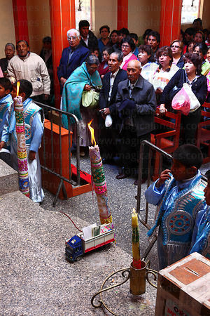 Congregation during mass for Alasitas festival, model truck on floor, Puno, Peru