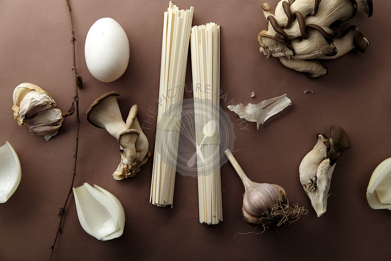Asian cuisine ingredients on brown background