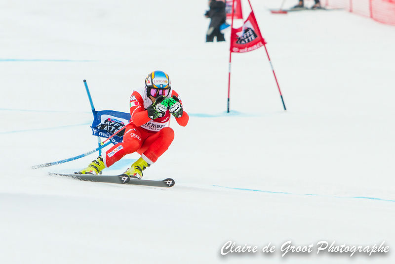 Italian Roberto Nani makes contact with a gate in the men's Giant Slalom finals.