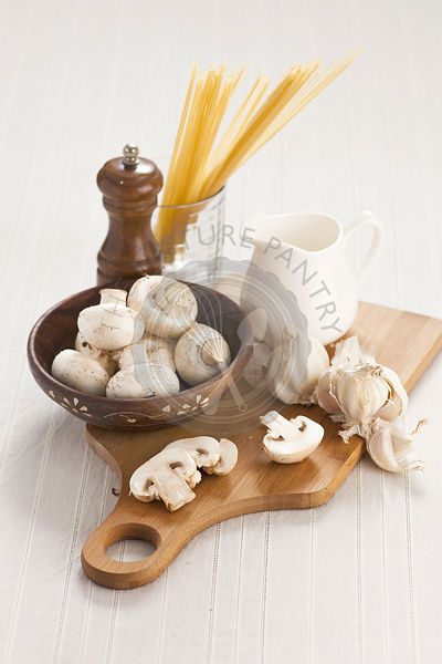 Still life with spaghetti mushrooms and garlic