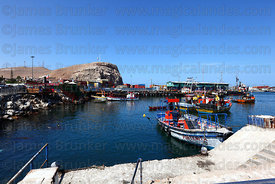View across fishing port, El Morro headland in background, Arica, Region XV, Chile