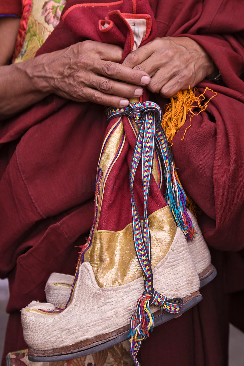 Hemis Gompa Priest Holding Traditional Ceremonial Shoes