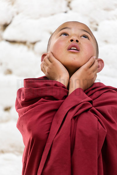 Young Monk Blocking his Ears before a Thunder Flash goes off