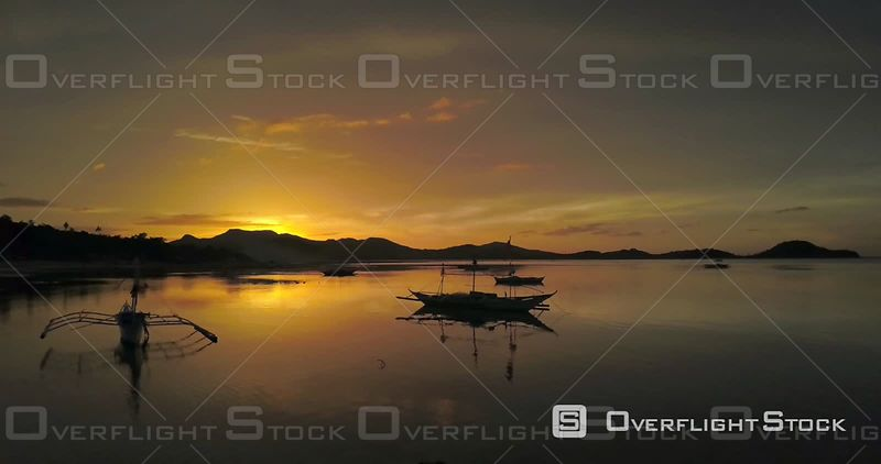 Fishing Boats in Sicogon Island at sunset. Drone Video Philippines