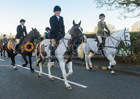 Richard Trembath, Frankie Wyatt leaving the meet - The Cottesmore Hunt at Pickwell Manor 28/12