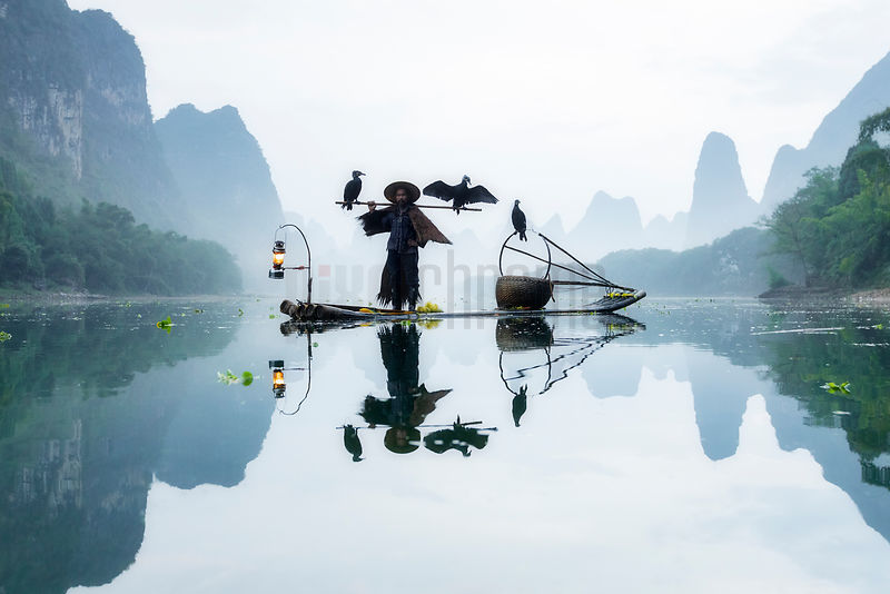 Fisherman in the Li River at Dawn