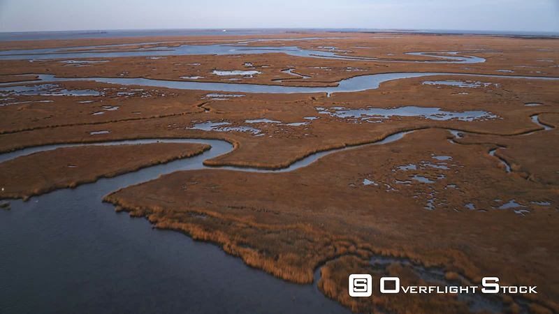 Low over water and marshy islands west of Brigantine, New Jersey. Shot in November