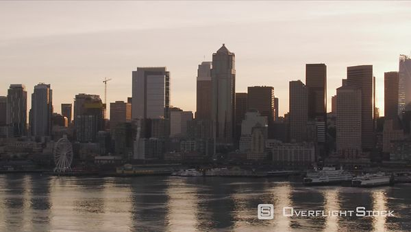 Seattle, Washington Sun peeks out from behind downtown Seattle buildings at sunrise.  Shot with Cineflex and RED EpicW Helium.