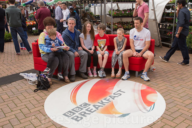 Family sit on the famous BBC Breakfast Red Sofa in Banbury Market