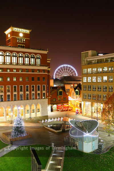 Brindleyplace, central square, Birmingham, at christmas time showing the big wheel.