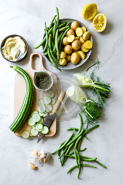 Ingredients for Green goddess potato salad. Potatoes, fennel, lemon, cucumber, green beans.
