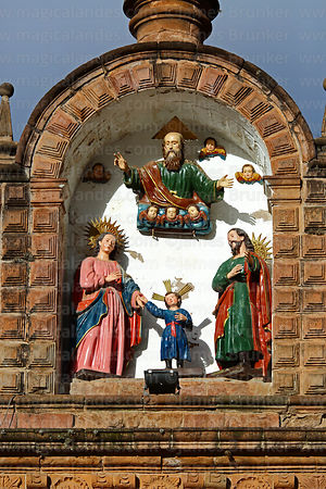 Statues of Mary, Joseph, infant Jesus and God on top of facade of the Temple of the Holy Family / Templo de la Sagrada Familia, Cusco, Peru