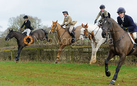 jumping a hedge at Goadby Hall - The Belvoir Hunt at Goadby Hall 24/12