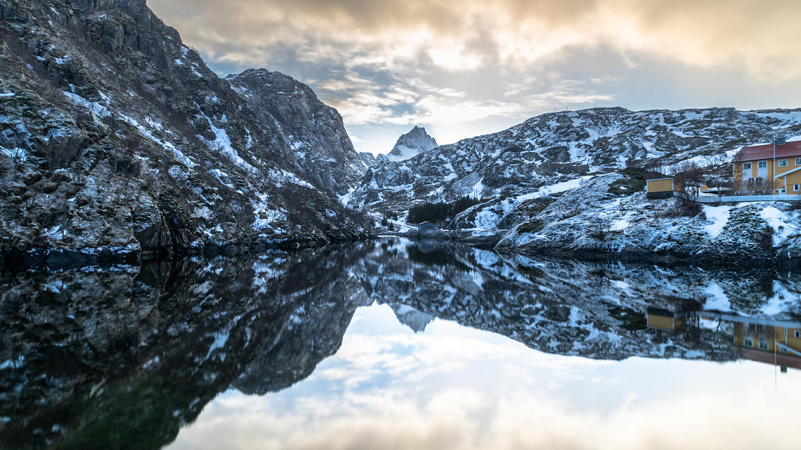 Mountains reflected in fjord