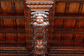 Detail of carved wooden heads on balcony support of Archbishop's Palace, Plaza de Armas, Lima, Peru