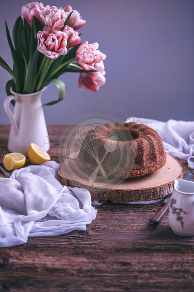 Bundt cake on a rustic wooden table