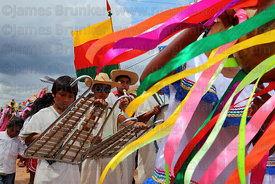 Schoolboys playing xylophones during main procession of festival, San Ignacio de Moxos, Bolivia