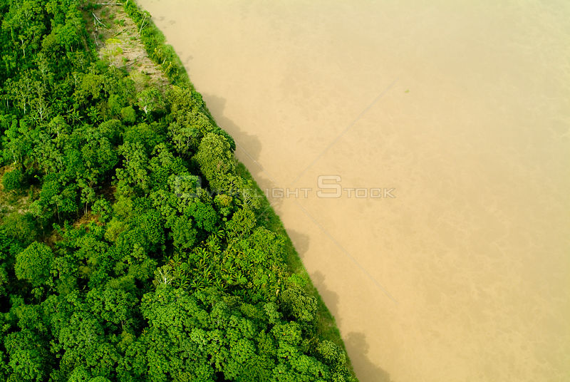 Aerial view of Amazon rainforest and river, Peru